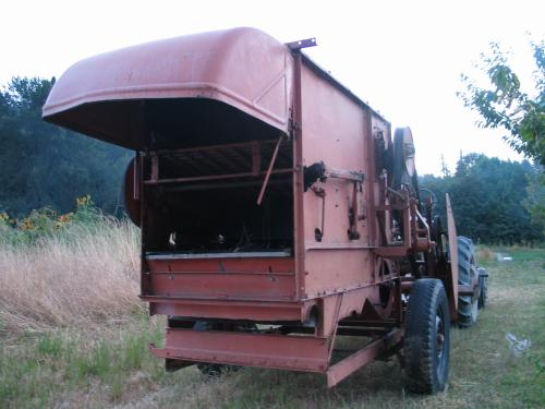 Stationary field thresher